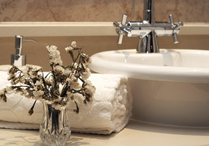 stylish bathroom sink basin with a terry cloth towel